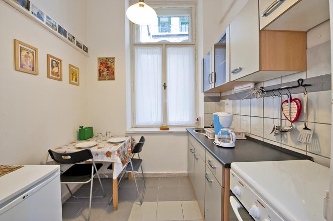 National Opera Apartment Budapest- kitchen with a dining table