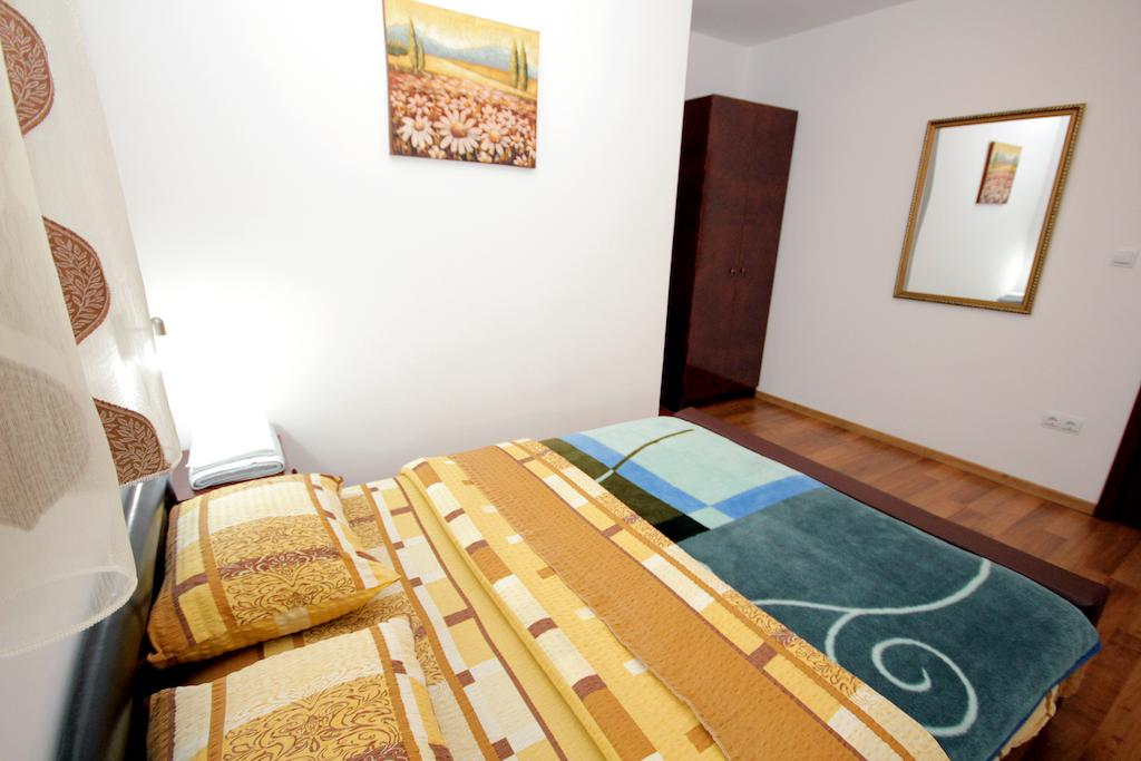 Two-Bedroom Apartment - yellow double bed