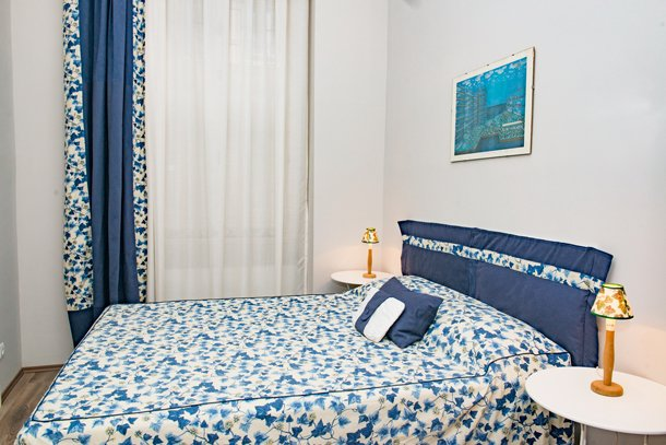 West End City Center Apartment Budapest - blue double bed