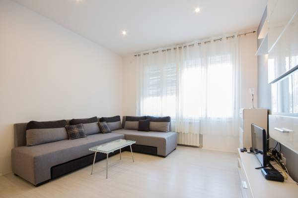 Deluxe one bedroom apartment - living room with sofa