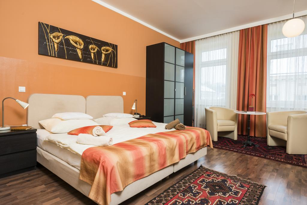 Charming One-Bedroom Ferchergasse Apartment - beds and sofa chairs