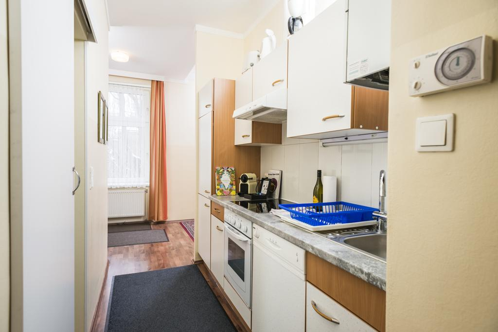 Charming One-Bedroom Ferchergasse Apartment - kitchen and corridor