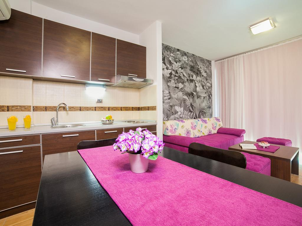 One-Bedroom Apartment - dining table and kitchen