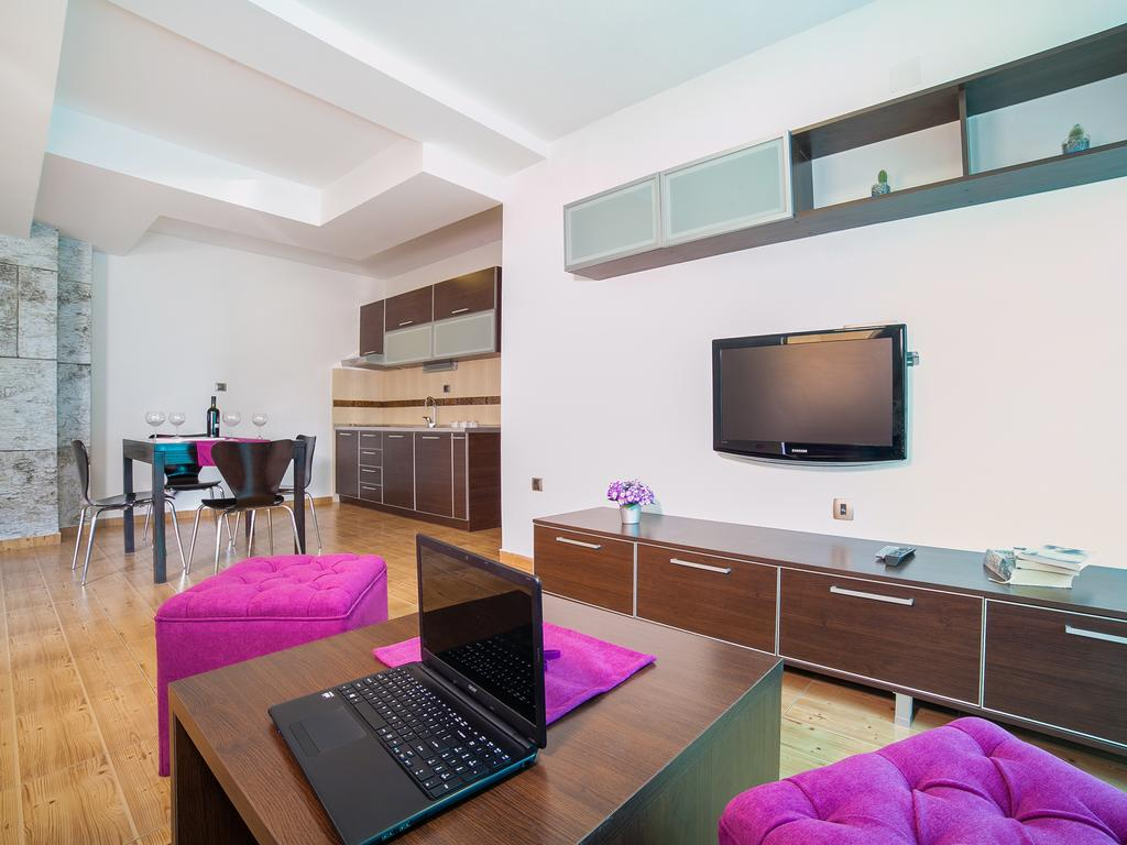 One-Bedroom-Apartment-with-Balcony-laptop-and-tv