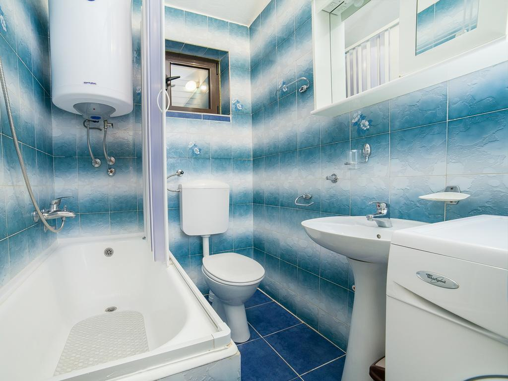 Two-Bedroom Apartment - blue bathroom