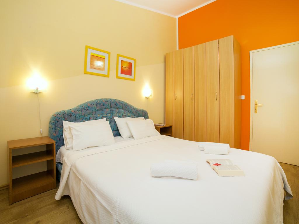 Two-Bedroom Apartment - blue double bed